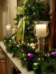 Green and purple with candles makes a beautiful Christmas Mantle Noel Christmas, Christmas Crafts, Green Christmas, Christmas Lights, Christmas Colors, Fire Place Christmas Decor, How To Decorate For Christmas, Natural Christmas, Christmas Ornaments