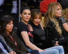 High spirits: She looked like she was having a great time as she took in the action courtside at the alongside her pal Hailey Baldwin