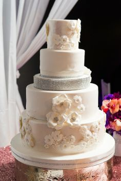 White wedding cake with rhinestones and flower detailing // Cory Ryan Photography // http://www.theknot.com/submit-your-wedding/photo/81bd26e4-07bb-4e23-b908-80e7f0f4e34e/Whitney-and-Jordan-Austin-TX