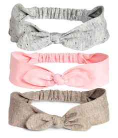 Light pink. Jersey hairbands with attached bow at front and elastication at back of neck.