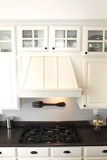 Love the glass top cabinets and the vent box
