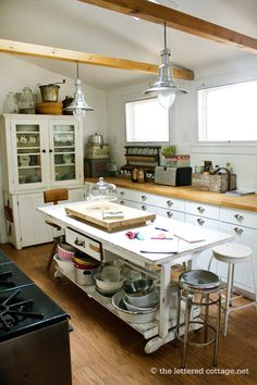 I love the simple coziness of this kitchen..via the lettered cottage