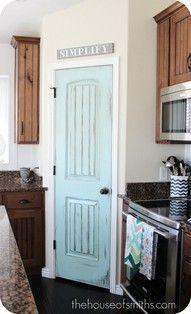 Robins egg blue or black closet door. Faux glass knob?