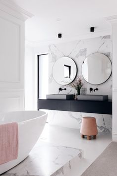 marble bathroom wall cladding, vanity top floating in black .