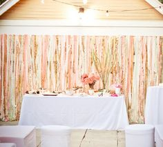 Peach and silver and ivory ribbon backdrop - I wanna make something like this for the head table backdrop..collect streamer material and clear strong line to attach too. We could hang from suction cup hooks or even a strong tape.