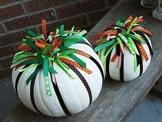 Spray painted pumpkins with ribbon