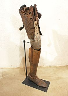 Pre Civil War Wood, Iron, Leather and Zinc Prosthetic Leg, American, c. 1840's. This prosthetic leg was found in Woodhull, Illinois. The sculptural leg is made of hand carved wood, leather and hand forged iron and zinc.