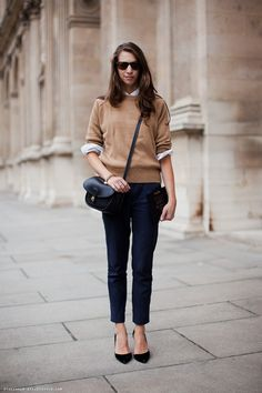 Susan Cernak- senior fashion editor of Glamour magazine looks casual-FAB in cropped pants, pointed pumps, and loose sweater.. matured intuition.