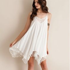 """Notice"" Lace Hem Strappy Dress Strappy dress with a gorgeous lace hem. Double layered. Fully adjustable straps. Available in ivory and black. This listing is for the IVORY. Runs half a size to a size large. Brand new. NO TRADES. PRICE FIRM. Bare Anthology Dresses Mini"