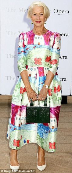 She's a word of art: The 70-year-old, looking younger than her age as always, slipped into a colourful ankle-length frock decorated with red flowers, white houses, rainbows and blue skies of the kind a child might draw