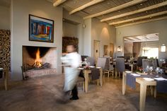 Great roaring fire in a fireplace made from klompies at Catharina's Restaurant at Steenberg Hotel Restaurant Fireplace, Cape Town, New Homes, House, Fireplaces, Clay, Google Search, Home Decor, Fireplace Set