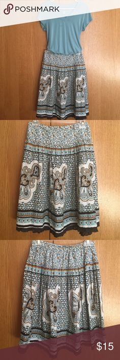 Pretty cotton skirt by Fire Los Angeles Light teal, off white, light and dark brown colored cotton skirt. Soft and pretty! 14 inches waist, 22.5 inches length. Back half of waist is stretchy. No flaws, just my waist is too big! Fire Los Angeles Skirts Midi