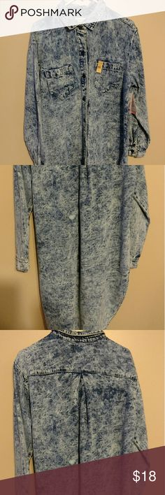 Vibrant Stonewashed Denim Shirt dress This NWT well made Hi Lo Denim button up shirt dress is a must for any Posh Fashionista. This fashionable gem is a size large and is surely to get you numerous compliments. This is a definite trendsetter item. Happy Poshing Vibrant from LoveCulture Dresses High Low