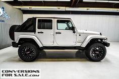 Lifted 2011 Jeep Wrangler Unlimited Sahara Manual Trans