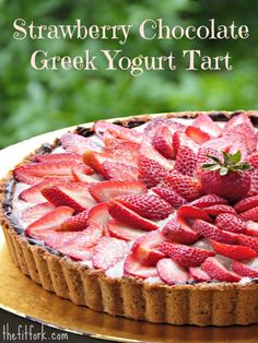 Strawberry Chocolate Greek Yogurt Tart with Coconut Almond Crust -- grain-free, gluten-free, paleo-friendly. This healthy dessert recipe is so gorgeous with berries, but also packs a punch of protein from the yogurt which is only lightly sweetened with Stevia. A delicious yet nutritious way to celebrate a spring or summer holiday, birthday, baby or bridal shower, graduation or other special event!  | thefitfork.com