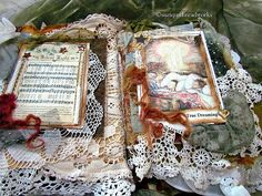 """Several months ago I was approached by a customer   to create a """"Christmas Lace Book/Journal using   rusted items, Arthur Rackham images ..."""
