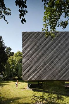 Family house extension by Franz Architekten clad with diagonal strips of larch