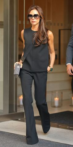 Victoria Beckham in shell top and flare pants of her own design.