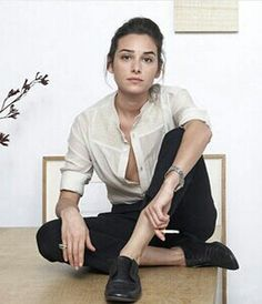Serious - in black and white. Hair pinned back. Ankles open + stylish flats.