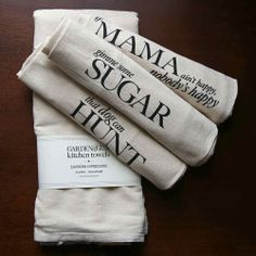 """These charming kitchen towels bear endearing sayings indicative of Southern warmth and hospitality. Each set includes a """"THAT DOG CAN HUNT,"""" """"IF MAMA AIN'T HAPPY, NOBODY'S HAPPY,"""" and """"GIMME SOME SUGAR"""" towel. Perfectly unique and functional, this set makes a great hostess gift for the kitchen or bar."""