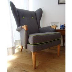 professionally re-upholstered parker knoll wing chair model number chair has been recovered in a charcoal grey pure wool and piped in a funky lime green with matching covered buttons. Parker Knoll Chair, Knoll Chairs, Farmhouse Table Chairs, Wingback Chair, Swivel Chair, Puff, Wing Chair, Retro Furniture, Upholstered Furniture