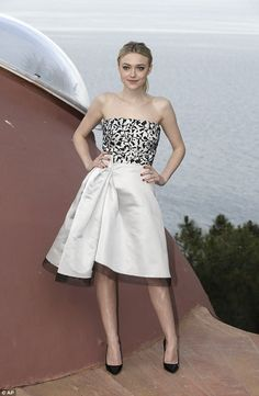 Knock-out: She wore a satin number which had a monochrome fitted bodice and a full-skirted...