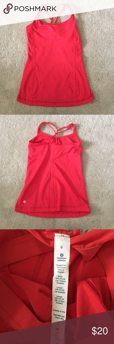 Red Lululemon Tank Top This form fitting tank top has a built-in mesh bra and thin straps that create an X on the back. lululemon athletica Tops Tank Tops