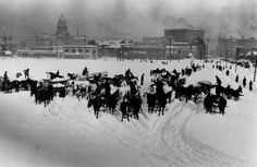 Civic Center area of Denver, Colorado in 1913 during snow removal following worst blizzard on record. There was no place to put the snow but in the open area in center of the city!