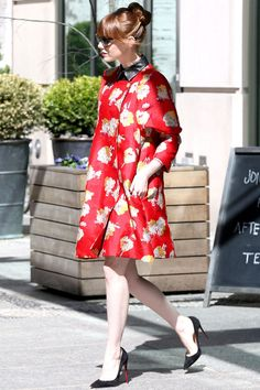 Emma Stone in a floral coat – love the colour and print (and also the sack-like shape) but those heels are stupidly high.