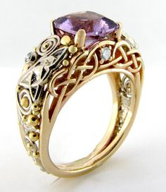 Celtic Ring with amethyst and diamonds. this is freaking beautiful. This kinda reminds me of my engagement ring in how it's raised.