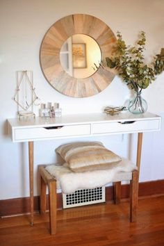 If you're looking for a chic alternative to your standard vanity, check out this super-glam creation. Try Ikea's EKBY ALEX shelving with old-school wooden legs and a sheepskin-covered bench to create a gorgeous place to spend your mornings.