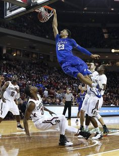 Kentucky Wildcats guard Jamal Murray (23) dunked on South Carolina Gamecocks guard Justin McKie (20) as the University of Kentucky played the University of South Carolina at Colonial Life Arena in Columbia, Sc., Saturday, February 13, 2016. This is second half men's college basketball action. UK won 89-62.
