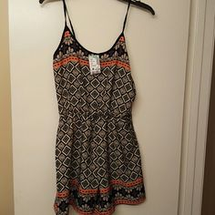 Brand new Romper Brand new Romper with tags, very cute and great for summer Papaya Other