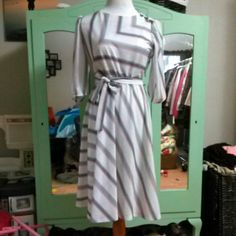 VINTAGE Chevron and stripe dress Brand: not listed Size: 12, fits like a modern 6 Color: gray, pink Condition: very good, two small (pinpoint sized) stains on the chest area, see photo #4 Dresses Midi