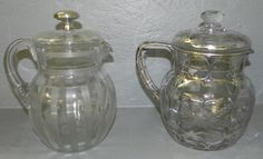 Silver overlaid lemonade pitcher and silver topped etched  lemonade pitcher