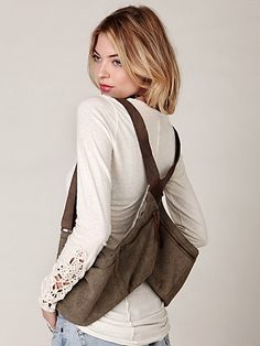 This is essentially what I want. Free people made this one 2 years ago, of course it can't be found now. Perhaps I try to make one?    Free People Holster Festival Pack