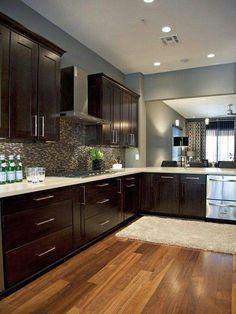 Dark Wood Cabinets, Light counter tops, natural flooring
