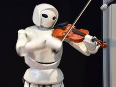 A violin playing robot, a series of humanoid robots from Toyota Partner Robot, is displayed at a robot event for children in Tokyo on August Real Robots, Robots For Kids, Humanoid Robot, Future Trends, Lessons For Kids, No Worries, Superhero, Shit Happens, August 9