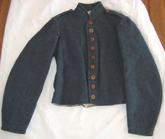 This cadet gray Richmond Depot jacket, picked up at the Battle of the Wilderness by a soldier in the 5th Maine Infantry is typical of a late war variant with shoulder straps and Confederate-issue wooden buttons. By the time the Richmond Depot made this jacket, it had standardized with a nine-button front, two-piece sleeves, six-piece body, and, generally made of imported, cadet gray kersey. Artifact and image courtesy of the Fifth Maine Museum, Peak's Island, Maine.