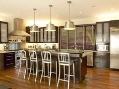 While stainless steel is certainly a high-style look, too much of it can make a kitchen feel cold and uninviting. Here, the plethora of metal is warmed up with dark wood cabinetry.