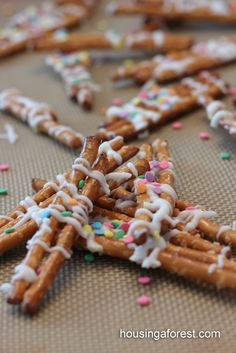 chocolate drizzled pretzel sticks with sprinkles...very easy and fun!