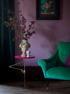 Quirky boho-inspired flamingo side table, paired with velvet emerlad green armchair and purple walls, both by Matthew Williamson. More at http://www.redonline.co.uk