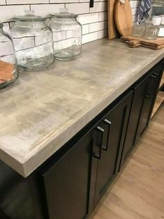 Concrete Countertops, Subway Tiles And Black Cupboards Inspiration