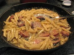 """Rita's Recipes: Easy Sausage Alfredo-1 pkg. Hillshire Farm® Smoked Sausage,  diagonally cut into 1/4"""" slices 8-12 oz. pasta, cooked, drained 2 cups heavy cream 2 teaspoons Cajun seasoning 1/2 cup grated Parmesan cheese"""