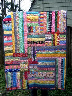 """Finished baby quilt based on the Garden Path quilt in """"Freddy & Gwen Collaborate Again"""" Quilted in the ditch, bound in dark gray solid. Approx 40 x 50""""."""