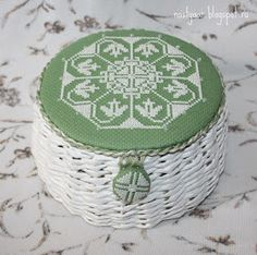 Cute idea for finishing - a lid for a small basket plus a matching cross stitched button.