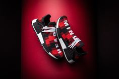 "Pharrell, who is known for being a street style icon as much as he is a musician, lends some of his fashion sensibilities to those closest to him on this alternate friends-and-family-only red colorway of the adidas NMD Hu ""Plaid Pack. Red And Black Plaid, Red Plaid, Adidas Nmd, Adidas Sneakers, Adidas Human Race, Billionaire Boys Club, Red Hood, Pharrell Williams, Black Accents"