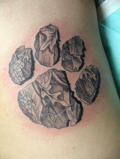 hmmm ... I like it:  camo pawprint tattoo.  I'd like a dog's print better though, I think