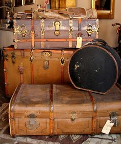When traveling by ship... vintage cases, luggage, hat box, small ship cruising, clasps