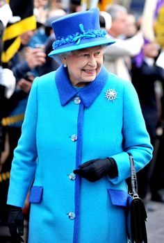 Queen Elizabeth II arrives at Manchester Picadilly train station on November 14, 2013 in Manchester, England.